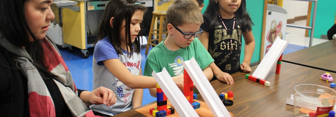 "A.P. Morris students participated in STEAM Night with their families. These students built ramps as part of the ""sledding challenge."""
